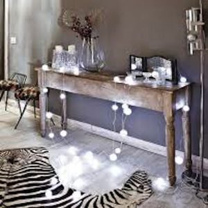 Add whtie twinkle lights to the entry of your house. or rest them on a long table