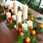 Pine, oranges, and white candles for a unique thanksgiving centerpiece